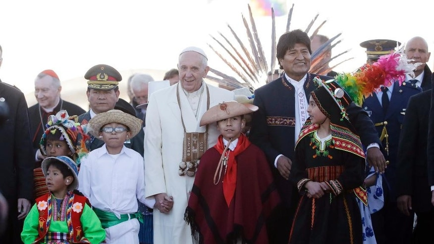 Bolivia's President Evo Morales escorts Pope Francis as the pope prepares to depart Viru Viru airport in Santa Cruz, Bolivia, Friday, July 10, 2015. The pope is departing for Paraguay as part of his three-nation South American tour. (AP Photo/Eduardo Verdugo)