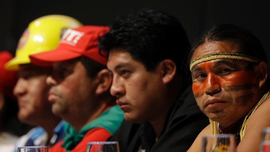 "Delegates attend the World Meeting of Popular Movements in Santa Cruz, Bolivia, Thursday, July 9, 2015. Pope Francis apologized for the sins and ""offenses"" committed by the Catholic Church against indigenous peoples during the colonial-era conquest of the Americas at the encounter attended by indigenous groups and other activists, and in the presence of Bolivia's first-ever indigenous president, Evo Morales. (AP Photo/Gregorio Borgia)"