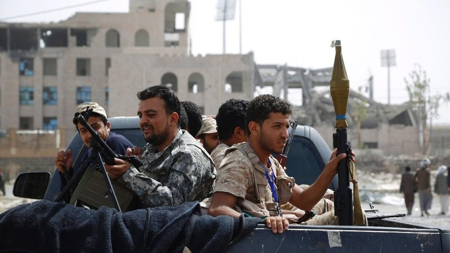 Shiite fighters, known as Houthis, ride in a pickup while patrolling in a street in Sanaa, Yemen, Friday, July 10, 2015. More than 3,000 people have been killed since March, when a Saudi-led and U.S.-backed coalition began launching airstrikes against the rebels who seized control of the capital and other cities starting September. (AP Photo/Hani Mohammed)