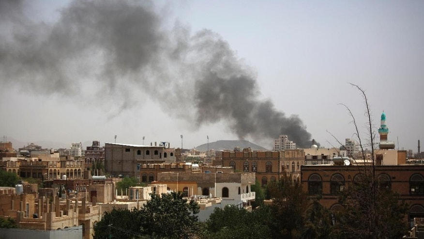 Smoke rises after a Saudi-led airstrike in Sanaa, Yemen, Friday, July 10, 2015. More than 3,000 people have been killed since March, when a Saudi-led and U.S.-backed coalition began launching airstrikes against the rebels who seized control of the capital and other cities starting September. (AP Photo/Hani Mohammed)