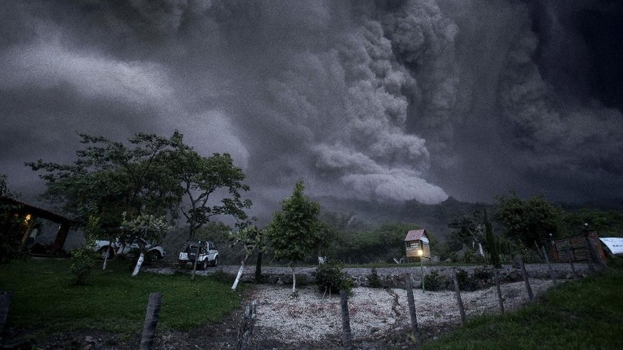 Clouds of ash fill the sky after an eruption by the Colima volcano, known as the Volcano of Fire, near the town of Comala, Mexico, Friday, July 10, 2015. The volcano spewed ash more than 4 miles (7 kilometers) into the air and released some quantity of lava. People were advised to recognize a 3-mile (5-kilometer) perimeter around the peak. (AP Photo/Sergio Tapiro Velasco)