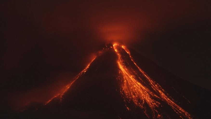 Lava flows down the banks of the Colima Volcano, also known as the Volcano of Fire, near the town of Comala, Mexico, Friday, July 10, 2015. The Colima volcano has erupted, spewing ash more than 4 miles (7 kilometers) into the air and releasing some quantity of lava. People were advised to recognize a 3-mile (5-kilometer) perimeter around the peak. (AP Photo/Sergio Tapiro Velasco)