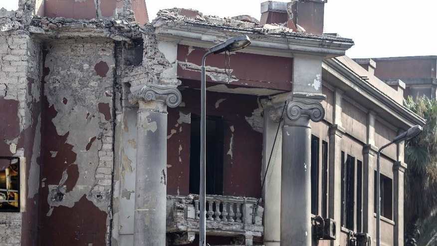 The Italian consulate shows heavy damage following a blast that killed at least one person in Cairo, Egypt, Saturday, July 11, 2015. An Italian embassy official said the consulate was closed at the time of the explosion and no staff members were injured. (AP Photo/ Mohammed el-Raai)