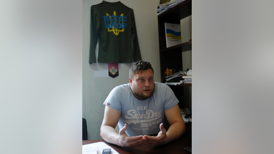 In this photo taken on Wednesday, June  24, 2015, Todor Panevsky, the commander of a self-defense organization In Odessa, speaks to the Associated Press in an interview in Odessa, Ukraine. Odessa lies more than 500 kilometers (300 miles) west of the front line in east Ukraine, where government troops are mired in a war of attrition against Russian-backed separatists. (AP Photo/Sergei Chuzavkov)