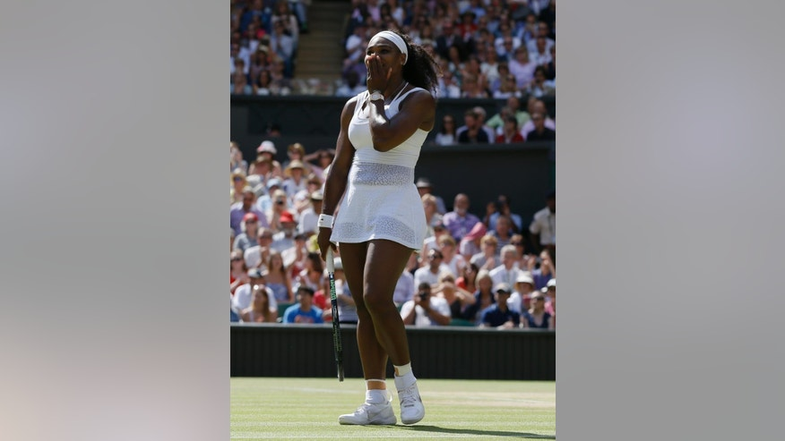 Serena Williams of the United States  gestures after winning the singles match Garbine Muguruza of Spain after the women's singles final at the All England Lawn Tennis Championships in Wimbledon, London, Saturday July 11, 2015. Williams won 6-4, 6-4.  (AP Photo/Kirsty Wigglesworth)