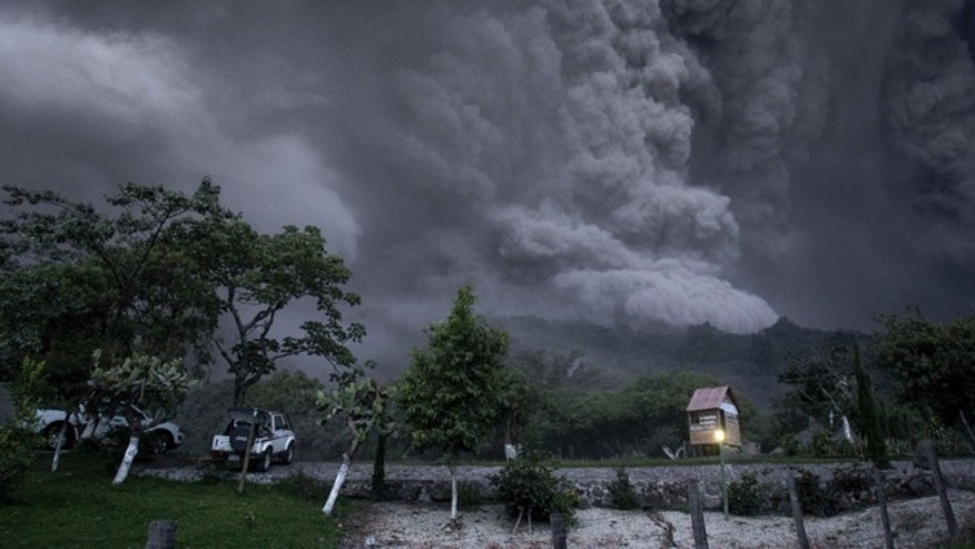 July 10, 2015: Clouds of ash fill the sky after an eruption by the Colima volcano, known as the Volcano of Fire, near the town of Comala, Mexico. The volcano spewed ash more than 4 miles into the air and released some quantity of lava. People were advised to recognize a 3-mile perimeter around the peak.