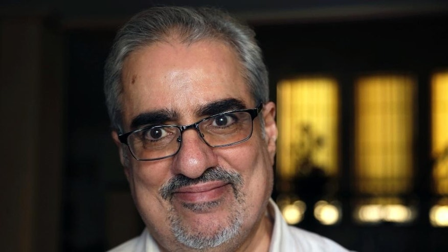 "FILE - In this Saturday, June 20, 2015 file photo, Bahraini Sunni Muslim opposition leader Ibrahim Sharif, who led the secular opposition WAAD (National Democratic Action Society) group, smiles to journalists at his home following his overnight release from prison, in Tubli, Bahrain. Bahraini authorities say they have arrested a top opposition leader less than a month after he was freed from prison. The Interior Ministry announced the arrest of former National Democratic Action Society head Sharif on its Twitter feed early Sunday, July 12, 2015 saying he was detained for ""violating the law."" (AP Photo/Hasan Jamali, file)"