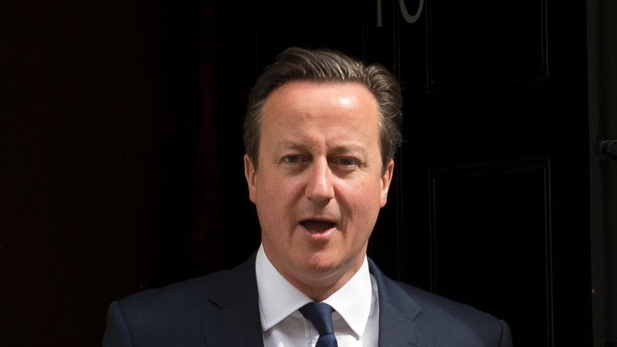 British Prime Minister David Cameron leaves  10 Downing Street in London, prior to the budget being unveiled at the Houses of Parliament, Wednesday, July 8, 2015. It is the first economic budget since Britain's Conservative party won the general election with an overall majority.  (AP Photo/Matt Dunham)