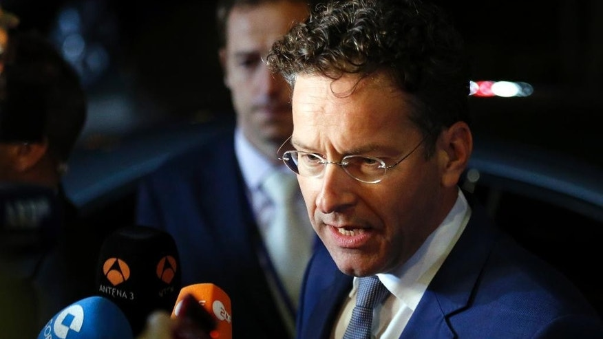 Dutch Finance Minister Jeroen Dijsselbloem speaks with the media as he leaves after a meeting of eurozone finance ministers at the EU Lex building in Brussels on Sunday, July 12, 2015. Greece's negotiators head to Brussels on Saturday armed with their reform proposals and parliamentary backing to seek a third bailout, but with the shadow of severe dissent from governing lawmakers hanging over them. (Francois Lenoir/Pool Photo via AP)