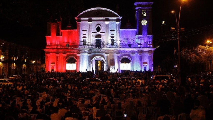 The Metropolitan Cathedral is illuminated in the colors of the Paraguayan flag during evening prayers with Pope Francis in Asuncion, Paraguay, Saturday, July 11, 2015. Francis is in Paraguay for three days, the last stop of his South American tour.  (AP Photo/Cesar Olmedo)