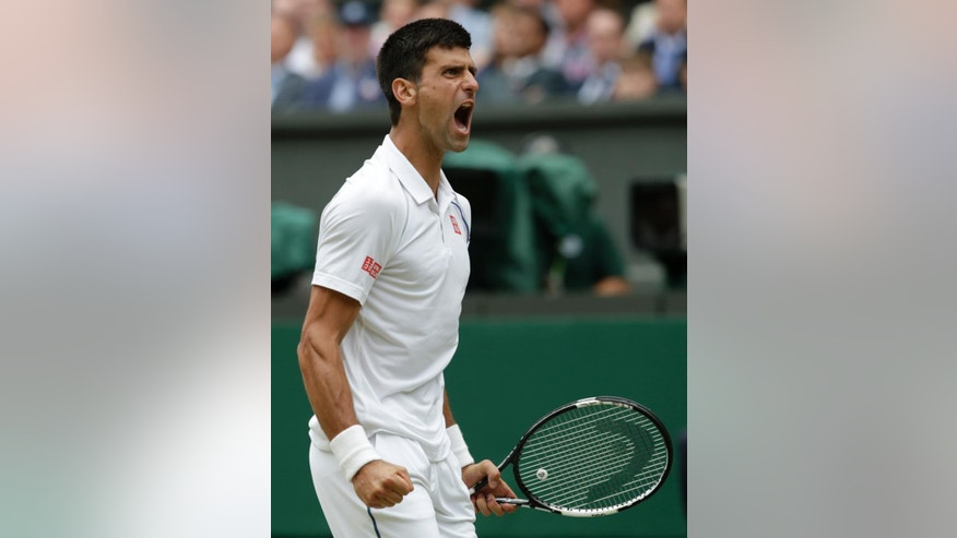 Novak Djokovic of Serbia celebrates winning a point during the men's singles final against Roger Federer of Switzerland at the All England Lawn Tennis Championships in Wimbledon, London, Sunday July 12, 2015. (AP Photo/Alastair Grant)