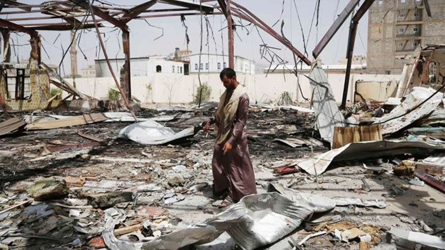 July 10, 2015: A man stands on the rubble of a wedding hall destroyed by a Saudi-led airstrike in Sanaa, Yemen.
