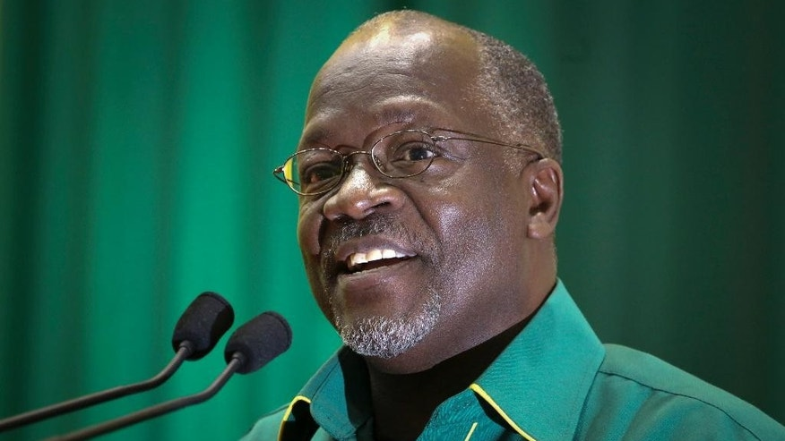 In this photo taken late Saturday, July 11, 2015, Tanzania's public works minister John Pombe Magufuli speaks at an internal party poll to decide the ruling party's presidential candidate, in Dodoma, Tanzania. Tanzania's ruling party, which has been in power for five decades, has chosen public works minister John Pombe Magufuli as its presidential candidate, making him the favorite to replace current president Jakaya Kikwete in the upcoming October election. (AP Photo/Khalfan Said)