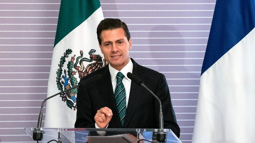 "Mexico's President Enrique Pena Nieto delivers his speech at the French-Mexican Academic and Scientific partnership headquarters in Paris, France, Monday, July 13, 2015. Authorities in Mexico continue their all-out manhunt for drug lord, Joaquin ""El Chapo"" Guzman, who officials say escaped Saturday from a maximum security prison. Officials say an opening in the shower area of his cell opened up to a one-mile tunnel. (AP Photo/Kamil Zihnioglu)"