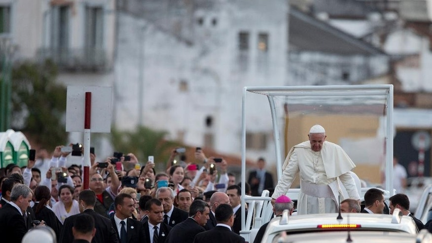 Pope Francis arrives aboard the popemobile to a meeting with the young in Asuncion, Paraguay, Sunday, July 12, 2015. The Pope addressed tens of thousands of young people waiting for him at a venue along the banks of the Paraguay River. (AP Photo/Natacha Pisarenko)