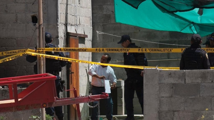 "Authorities investigate a half-built house near the Altiplano maximum security prison in Almoloya, west of Mexico City, Monday, July 13, 2015. A widespread manhunt that included highway checkpoints, stepped up border security and closure of an international airport failed to turn up any trace of Mexican drug kingpin Joaquin ""El Chapo"" Guzman by Monday, more than 24 hours after he escaped through an underground tunnel in his Altiplano prison cell. (AP Photo/Marco Ugarte)"
