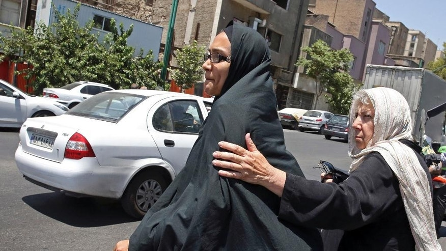 Mary Rezaian, right, mother of detained Washington Post correspondent Jason Rezaian and his wife Yeganeh Salehi, leave after a court hearing at the Revolutionary Court in Tehran, Iran, Monday, July 13, 2015. The closed-door trial of detained Washington Post correspondent Jason Rezaian, who has been detained in an Iranian prison for nearly a year, ended Monday after a third session, Iran's official IRNA news agency reported. Rezaian, 39, is being tried in a Revolutionary Court on charges including espionage and distributing propaganda against the Islamic Republic. U.S. officials, the Post and rights groups have criticized his trial and pressed for his release. (AP Photo/Vahid Salemi)