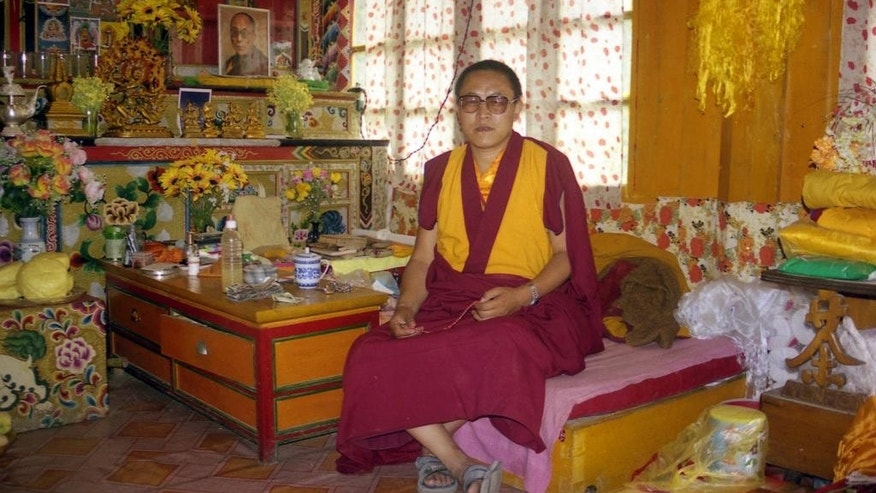 This photo taken June 1999 and released by Tsering Woeser on July 13, 2015, shows Tibetan lama Tenzin Delek Rinpoche in his home in Nyagqu County, also known as Yajiang County in the Garze Tibetan Autonomous Prefecture in southwestern China's Sichuan province. Relatives of Tenzin Delek Rinpoche were informed Sunday, July 12, 2015 that he has died in prison 13 years into serving a sentence for what human rights groups say were false charges that he was involved in a bombing in a public park. He was 65. (Tsering Woeser via AP)