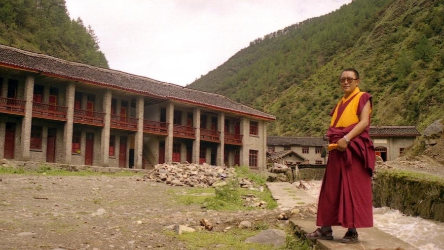 In this photo taken June 1999 and released by Tsering Woeser on July 13, 2015, Tibetan lama Tenzin Delek Rinpoche poses for a photo in Nyagqu County, also known as Yajiang County, in the Garze Tibetan Autonomous Prefecture in southwestern China's Sichuan province. Relatives of Tenzin Delek Rinpoche were informed Sunday, July 12, 2015 that he has died in prison 13 years into serving a sentence for what human rights groups say were false charges that he was involved in a bombing in a public park. He was 65. (Tsering Woeser via AP)