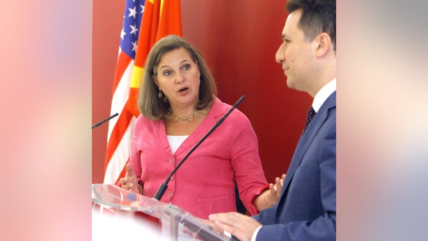 U.S. Assistant Secretary of State for European and Eurasian Affairs Victoria Nuland, left, talks to the media, looking at Macedonian Prime Minister Nikola Gruevski, right, after their meeting at the Government building in Skopje, Macedonia, on Monday, July 13, 2015.(AP Photo/Boris Grdanoski)