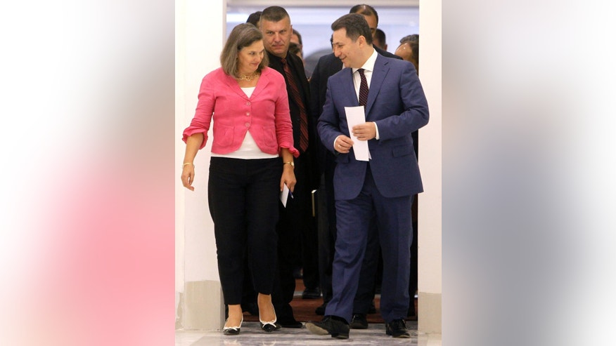 U.S. Assistant Secretary of State for European and Eurasian Affairs Victoria Nuland, left, looks at Macedonian Prime Minister Nikola Gruevski, right, as they walk together during their meeting at the Government building in Skopje, Macedonia, on Monday, July 13, 2015. (AP Photo/Boris Grdanoski)