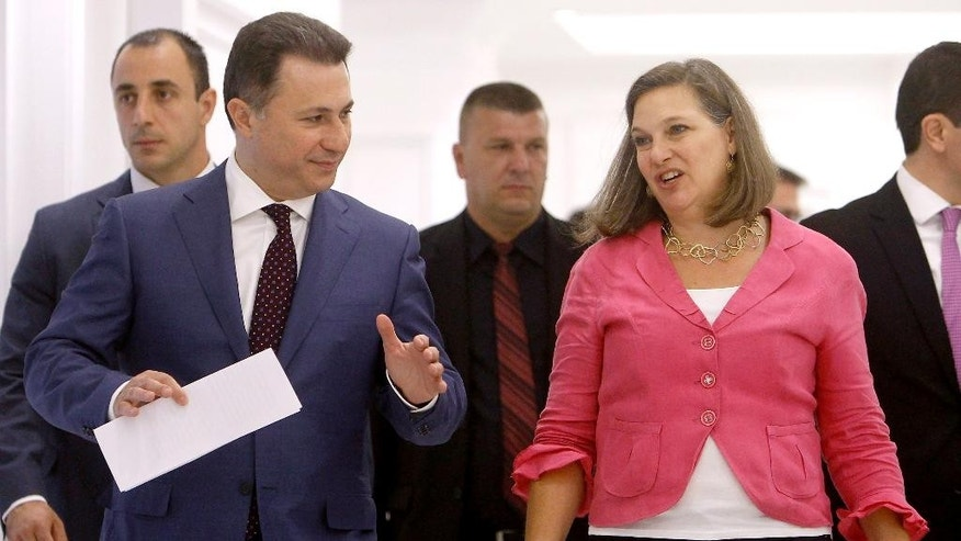 U.S. Assistant Secretary of State for European and Eurasian Affairs Victoria Nuland, right, talks with Macedonian Prime Minister Nikola Gruevski, left, as they walk together during their meeting at the Government building in Skopje, Macedonia, on Monday, July 13, 2015. (AP Photo/Boris Grdanoski)