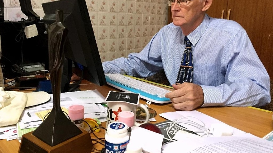 Alan Morison, Australian editor of the website Phuketwan, sits at his desk ahead of his appearance in court to face charges of violating Thailand's Computer Crime Act in Phuket, Thailand, Tuesday, July 14, 2015. Testimony begins Tuesday in a criminal defamation lawsuit the Thai navy has filed against a small news website over a report it posted alleging naval forces accepted money to abet or turn a blind eye to the seaborne trafficking of refugees from Myanmar. (AP Photo/Thanyarat Doksone)
