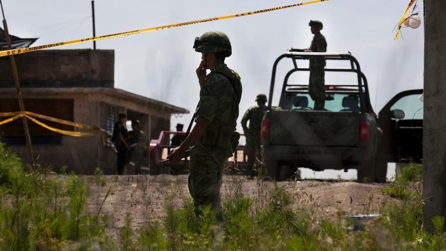 "Mexico's Interior Secretary Miguel Angel Osorio Chong, white shirt, arrives to the half-built house where drug lord Joaquin ""El Chapo"" Guzman made his escape through a tunnel from the Altiplano maximum security prison in Almoloya, west of Mexico City, Monday, July 13, 2015. A widespread manhunt that included highway checkpoints, stepped up border security and closure of an international airport failed to turn up any trace of ""El Chapo"" Guzman by Monday, more than 24 hours after he escaped through an underground tunnel in his Altiplano prison cell. (AP Photo/Marco Ugarte)"