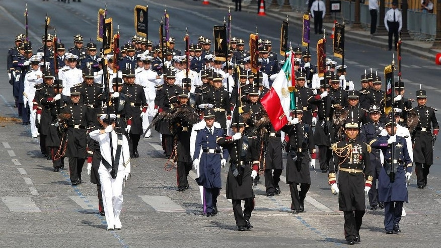 Mexican troops march down the Champs Elysees avenue in Paris, France, as part of Bastille Day parade Tuesday, July 14, 2015. French anti-terrorist forces join the traditional military parade celebrating Bastille Day, as the country's leadership tries to show its muscle against extremists abroad and at home. Mexico's president is the guest of honor at this year's event marking France's biggest holiday. (AP Photo/Michel Euler)