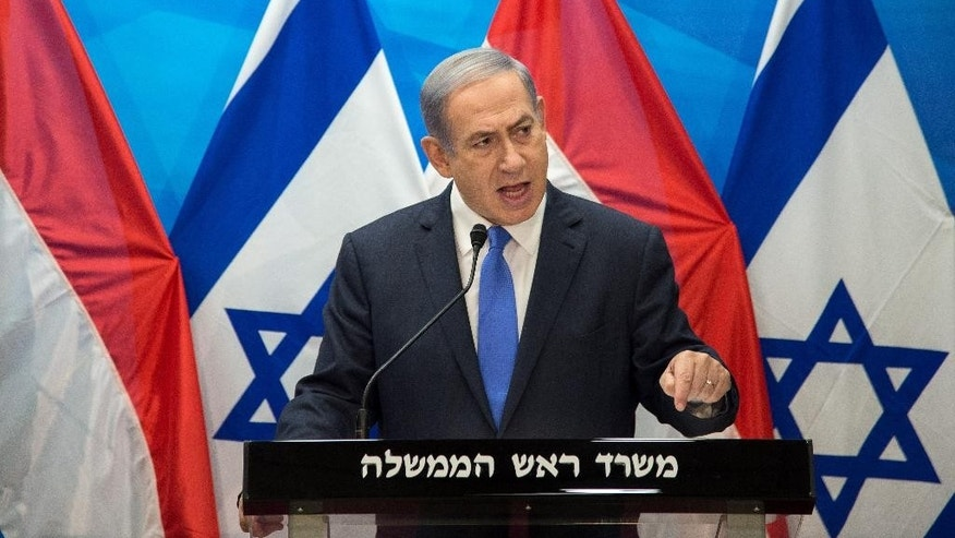 Israel's Prime Minister Benjamin Netanyahu speaks during a press conference with Dutch Foreign Minister Bert Koenders at the Prime Minister's office in Jerusalem, Tuesday, July 14, 2015. (Ahikam Seri/Pool Photo via AP)