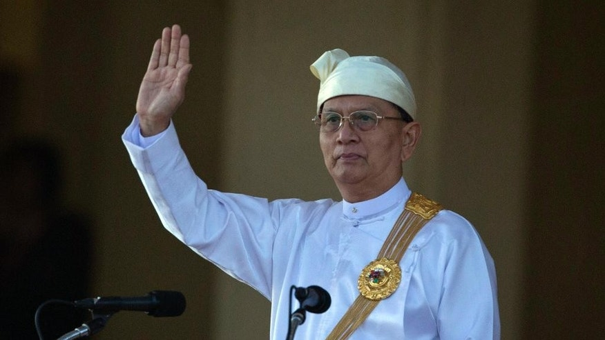 FILE - In this Jan. 4, 2015 file photo, Myanmar President Thein Sein waves during a ceremony to mark Myanmar's 67th anniversary of Independence Day in Naypyitaw, Myanmar. The president's office says he has not yet decided whether to pursue a second term in office but will base his decision on how the ruling party fares in parliamentary elections this November. His office denied a news report Tuesday, July 14, 2015 that quoted an anonymous official as saying Thein Sein would not run in parliamentary elections due to health concerns. (AP Photo/Gemunu Amarasinghe, File)