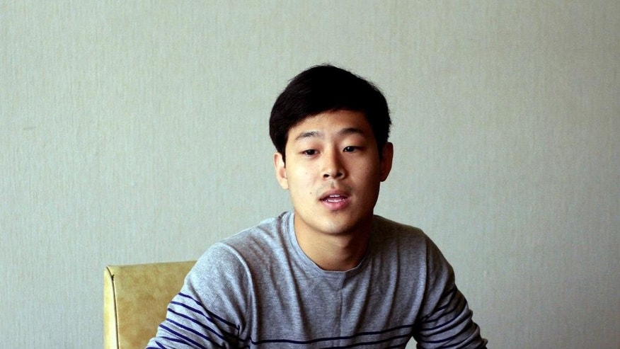 Won Moon Joo, a South Korean student at New York University, is interviewed at the Koryo Hotel in Pyongyang, North Korea Tuesday, July 14, 2015. Joo, who is being detained in North Korea says he hopes to be released soon and has told his family not to worry too much about him.  Joo was presented to the media in North Korea's capital, Pyongyang, on Tuesday. (AP Photo/Kim Kwang Hyon)