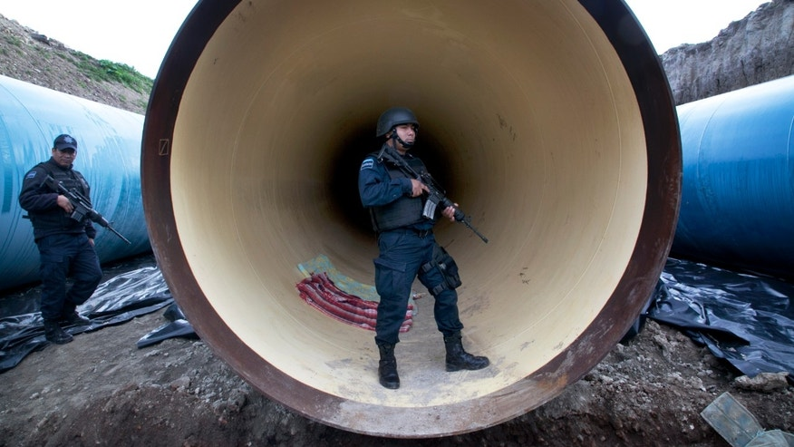 Federal police guard a drainage pipe outside of the Altiplano maximum security prison Sunday, July 12, 2015.