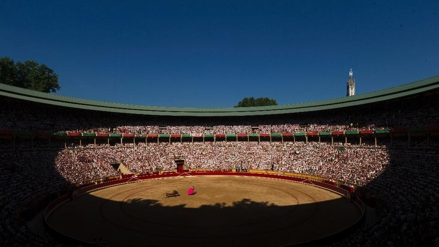 Spanish bullfighter Juan Jose Padilla performs with a Garcigrande ranch fighting bull during a bullfight of the San Fermin festival in Pamplona, Spain, Monday, July 13, 2015. Revelers from around the world arrive in Pamplona every year to take part on some of the eight days of party and the running of the bulls. (AP Photo/Daniel Ochoa de Olza)