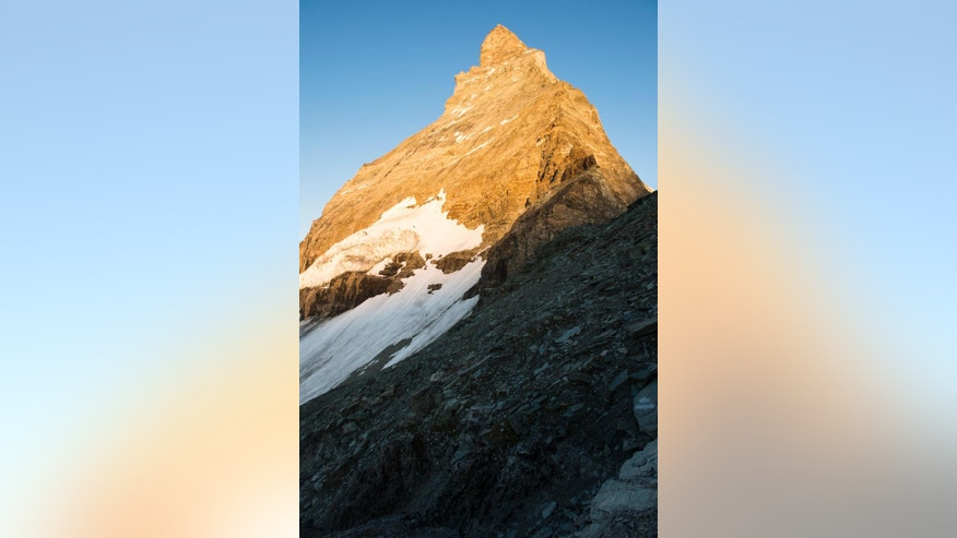 "The peak of the Matterhorn moutain is pictured during sunrise, Tuesday, July 14, 2015. Authorities in Switzerland have declared the iconic Matterhorn mountain off-limits for a day on the 150th anniversary of the first ascent. The so-called ""Matterhorn silence"" is intended to honor more than 500 climbers who have died trying to reach the top. (Dominic Steinmann/Keystone via AP)"