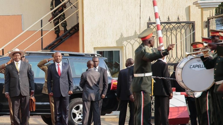 President of Uganda Yoweri Museveni, left, is welcomed by the President of Burundi, Pierre Nkurunzira, right, in Bujumbura, Burundi, Tuesday, July 14, 2015. Uganda's president has started mediating talks between Burundi's government and opposition groups that are opposed to President Pierre Nkurunziza's controversial bid for a third term. (AP Photo/Berthier Mugiraneza)
