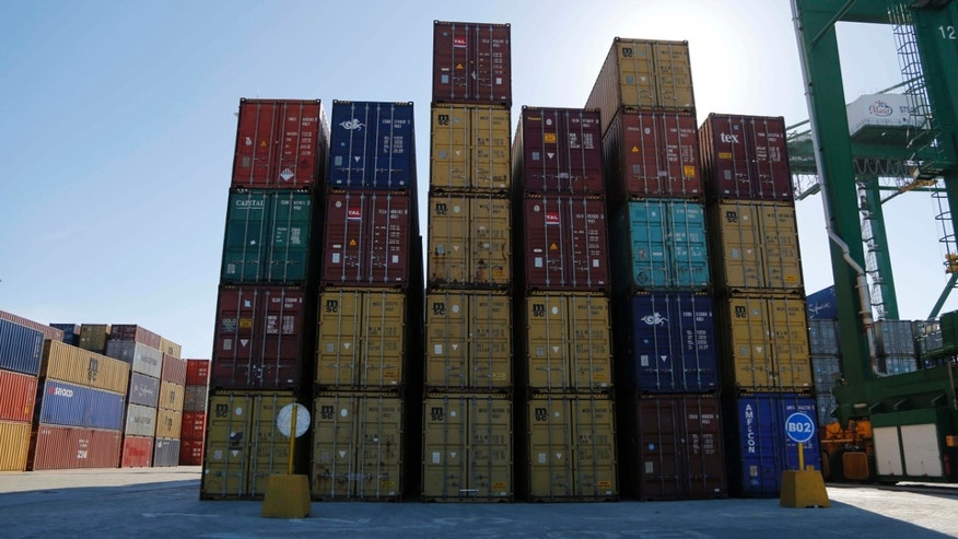 Containers lay stacked at the port in the Bay of Mariel, Cuba, Monday, July 13, 2015.