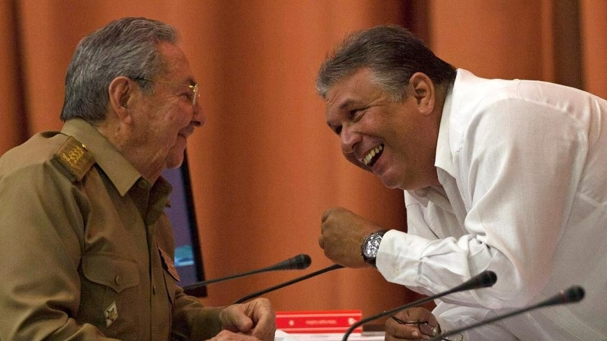 Cuba's President Raul Castro, left, speaks with Marino Murillo, vice president of the Council of Ministers, during a National Assembly session in Havana, Cuba, Wednesday, July 15, 2015. Castro is expected to speak to the body, in what would be his first public comments since the United States and Cuba announced they will re-establish diplomatic relations next Monday and reopen embassies in each other's respective capitals. (AP Photo/Ismael Francisco, Cubadebate)