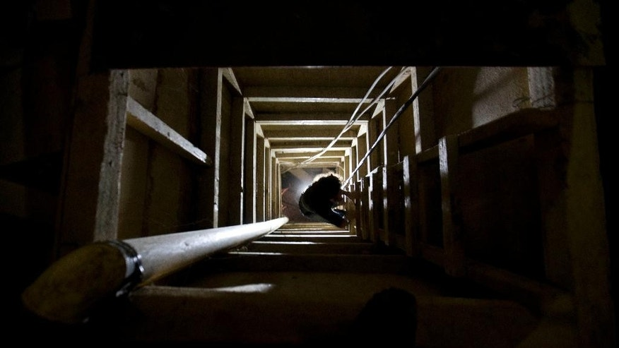 "A journalist climbs a ladder to get out of the tunnel that according to authorities, drug lord Joaquin ""El Chapo"" Guzman used to escape from the Altiplano maximum security prison in Almoloya, west of Mexico City, Tuesday, July 14, 2015. A widespread manhunt that included highway checkpoints, stepped up border security and closure of an international airport failed to turn up any trace of Guzman after he escaped through an underground tunnel in his prison cell on Saturday night. (AP Photo/Eduardo Verdugo)"