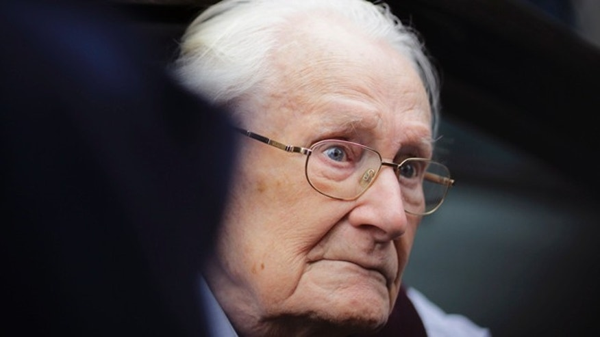 July 15, 2015: Former SS sergent Oskar Groening arrives for the judgement at the trial against him in in Lueneburg, Germany. Groening, 94, who is accused of helping to operate the death camp Auschwitz between May and June 1944, has been convicted on 300,000 counts of accessory to murder. The state court gave Groening a four-year sentence. (AP Photo/Markus Schreiber)