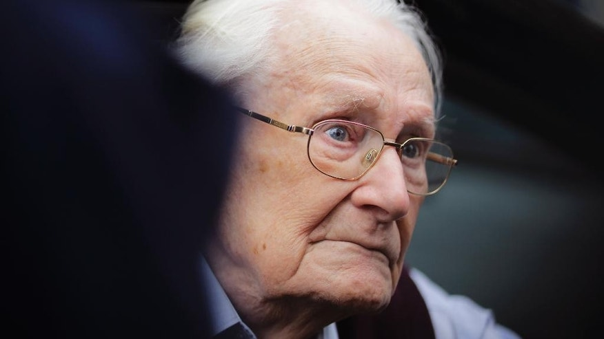 Former SS sergent Oskar Groening arrives for the judgement at the trial against him in in Lueneburg, Germany Wednesday, July 15, 2015. Groening, 94, who is accused of helping to operate the death camp Auschwitz between May and June 1944, has been convicted on 300,000 counts of accessory to murder. The state court gave Groening a four-year sentence. (AP Photo/Markus Schreiber)