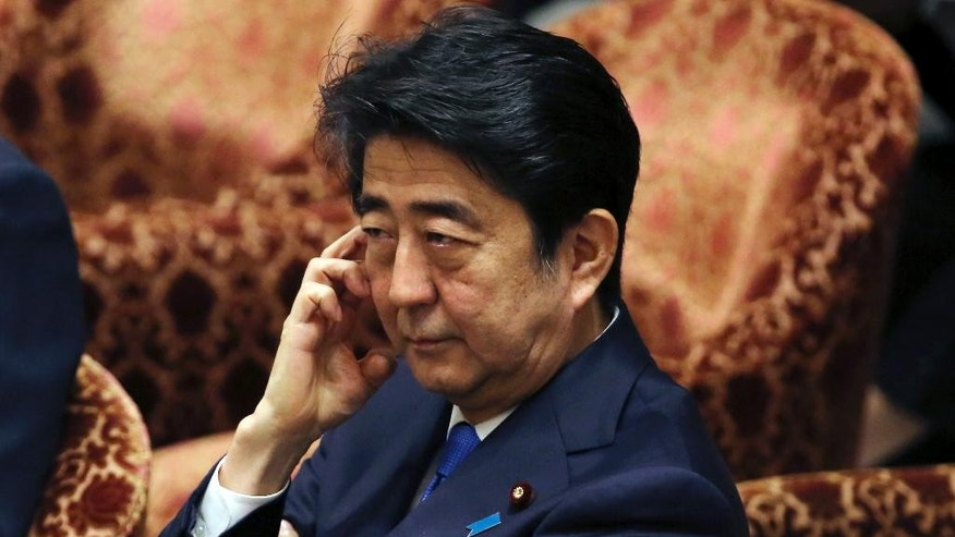 Japanese Prime Minister Shinzo Abe pauses during the lower house special committee on security legislation at the parliament in Tokyo, Wednesday, July 15, 2015.  The Japanese parliamentary committee has approved security legislation to expand the role of Japan's military despite vocal protests from opposition lawmakers and citizens. (AP Photo/Shuji Kajiyama)