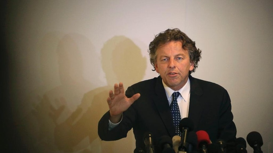 Dutch Foreign Minister Bert Koenders, speaks during a press conference at Roots Hotel in Gaza City, in the northern Gaza Strip, Wednesday, July 15, 2015. Koenders, visited the Kerem Shalom Crossing in southern Israel, which borders Gaza, to inaugurate a new security scanning system. The machine was donated by the Netherlands, and aims to increase the number of trucks crossing into Gaza from Israel. (AP Photo/Adel Hana)