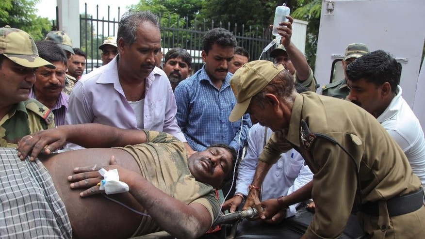 An Indian Border Security Force soldier injured in exchange of fire on the India Pakistan border is brought for treatment at the government medical college hospital in Jammu, India, Wednesday, July 15, 2015. Indian and Pakistani troops exchanged fire in the disputed Himalayan region of Kashmir on Wednesday, killing a woman and wounding at least four other people on the Indian side, officials said. (AP Photo/Channi Anand)