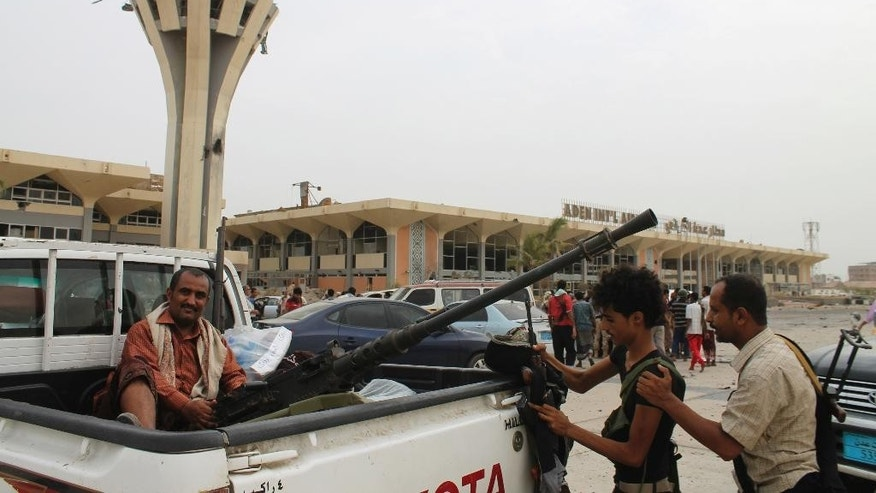 Fighters against Shiite rebels known as Houthis gather in front of the airport in the port city of Aden, Yemen, Tuesday, July 14, 2015. Yemeni forces battling the Shiite rebels in the country's south said they took control on Tuesday of the airport in the strategic port city of Aden, driving the rebels there into a part of the city jutting out into the sea. (AP Photo/Abo Muhammed)