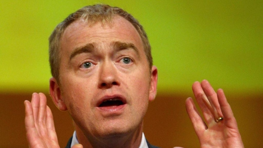 FILE - This is a July 1, 2015 file photo of Liberal Democrat Party politician  Tim Farron,  speaking in Birmingham England. Britain's centrist Liberal Democrats on Thursday July, 16, 2015  elected Tim Farron, as the party's new leader. (David Jones/PA  File Via AP)