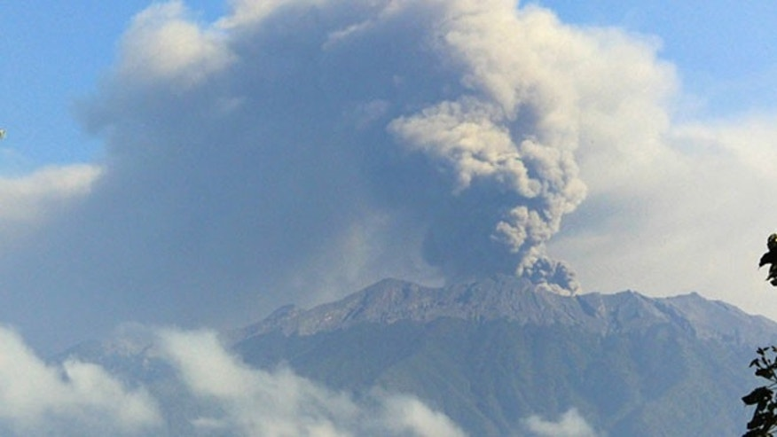 Mount Raung spews volcanic material into the air.