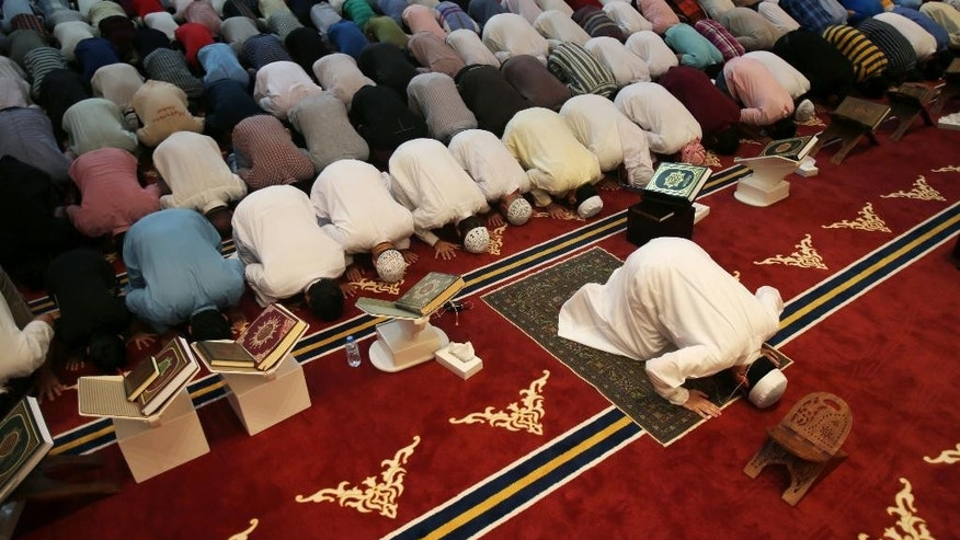 In this photo taken Wednesday, June 24, 2015, an Imam leads evening prayers after breaking their fast during the month of Ramadan at the Al Farooq Omar bin Al Khattab Mosque in Dubai, United Arab Emirates. Six months ago, Egypt's president called on Sunni scholars to reform the very discourse of Islam to keep up with modern-day challenges. The effort was given a boost during the Muslim fasting month of Ramadan, now in its last week, even as a call for violence by the Islamic State group triggered attacks across the Middle East and parts of Africa. (AP Photo/Kamran Jebreili)