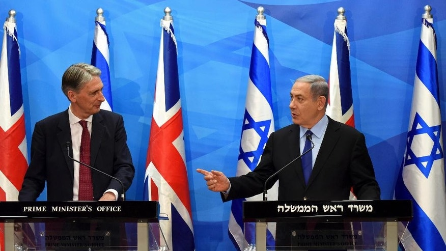 Visiting British Foreign Secretary Philip Hammond, left, and Israeli Prime Minister Benjamin Netanyahu hold a joint press conference in the prime minister's office in Jerusalem on Thursday, July 16, 2015. Netanyahu and Hammond sparred publicly Thursday over the international nuclear deal with Iran, veering off prepared comments to exchange sharply different positions toward the agreement. (Debbie Hill, Pool Photo via AP)