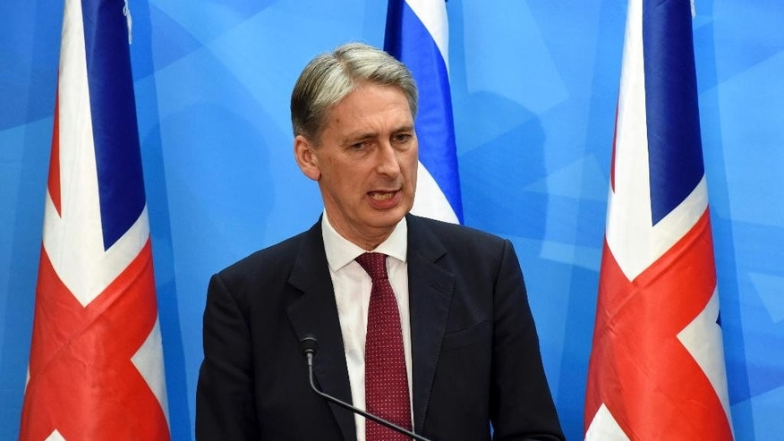 Visiting British Foreign Secretary Philip Hammond holds a joint press conference with Israeli Prime Minister Benjamin Netanyahu in the prime minister's office in Jerusalem on Thursday, July 16, 2015. Netanyahu and Hammond sparred publicly Thursday over the international nuclear deal with Iran, veering off prepared comments to exchange sharply different positions toward the agreement. (Debbie Hill, Pool Photo via AP)